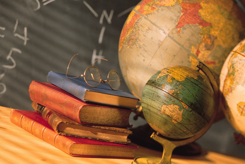 books and a globe in a classroom