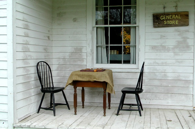 two chairs sitting on the porch of a historic general store